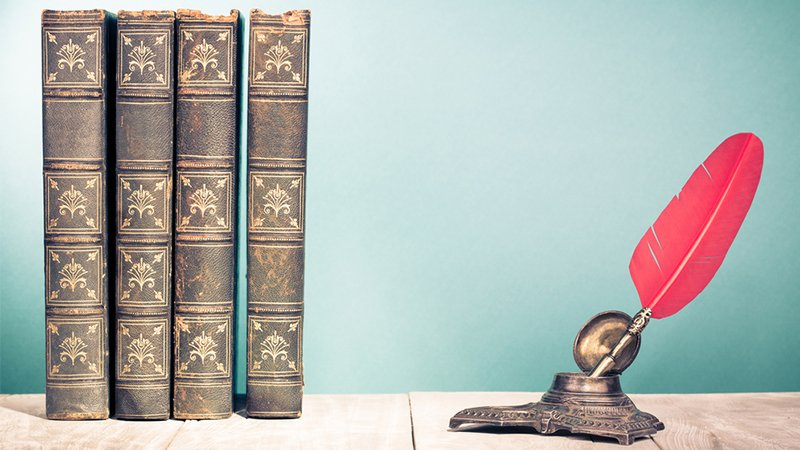 Über uns - Alte Bücher mit Feder und Tinte